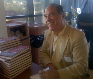 Bernie Trilling signing books at ShiftED meeting (photo by Kathy Baron, click to enlarge)