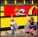 School bus as moving moving billboard for schools. (Source:  Campaign for a Commercial-free Childhood). Click to enlarge.